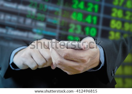 Businessman touch smart phone in hand with exchange rate blur background - stock photo