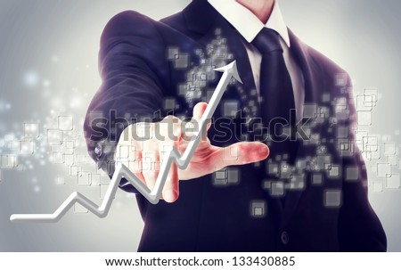 Businessman Touching a Arrow Indicating Growth - stock photo