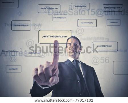 Businessman touching a button on a touchscreen - stock photo