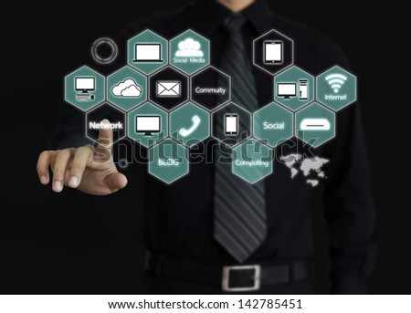 Businessman touching a Cloud Computing diagram - stock photo