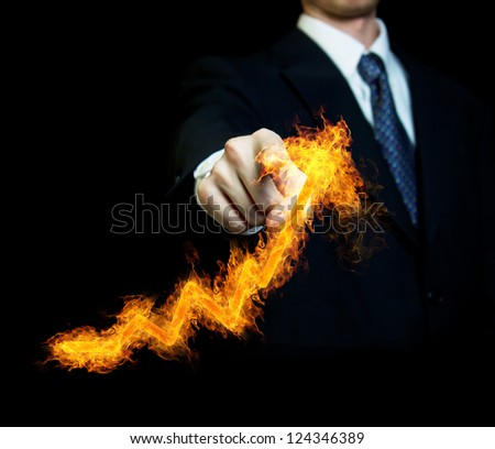 Businessman Touching a Graph Indicating Growth - stock photo