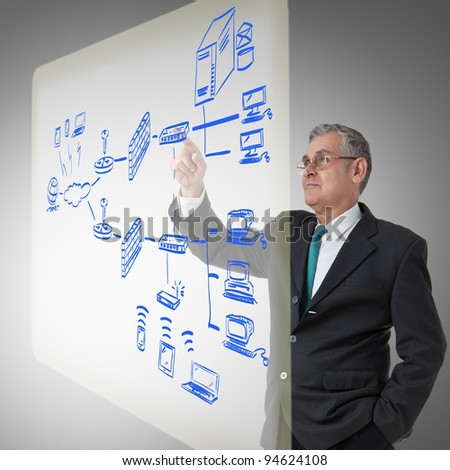 businessman touching a security plan for a firewall system - stock photo