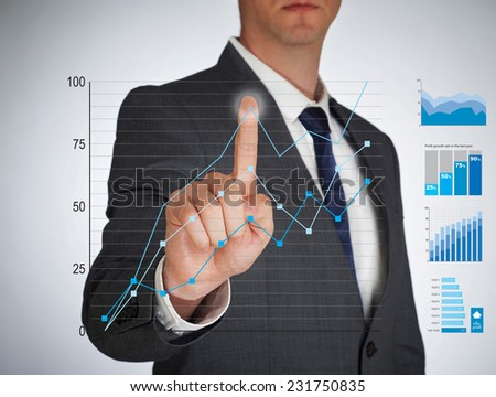 Businessman touching a virtual screen - stock photo
