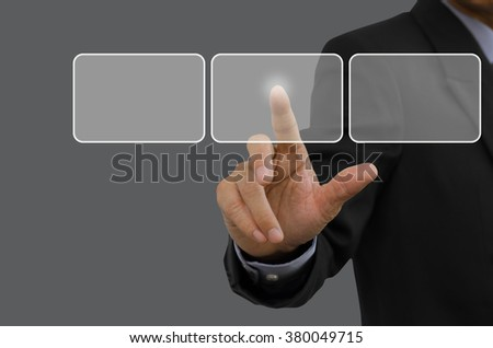 Businessman touching blank  buttons on virtual screen. - stock photo