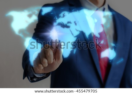 Businessman touching blue virtual world map on screen with blinking light