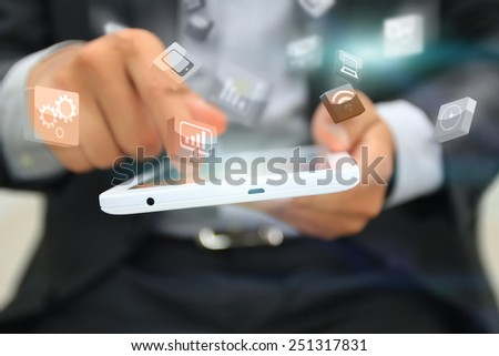 Businessman touching business icon on tablet. - stock photo