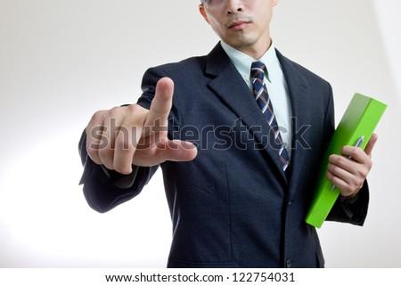 Businessman touching button - stock photo