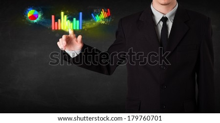 Businessman touching colorful modern graph system concept - stock photo