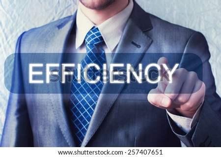 Businessman touching Efficiency Button on virtual screen - stock photo