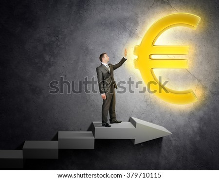 Businessman touching euro sign
