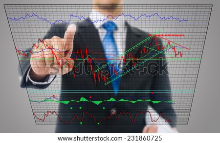 Businessman touching finance graph for trade stock market, business and technology concept. - stock photo