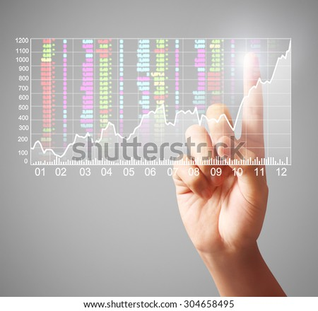 businessman Touching graph of work - stock photo