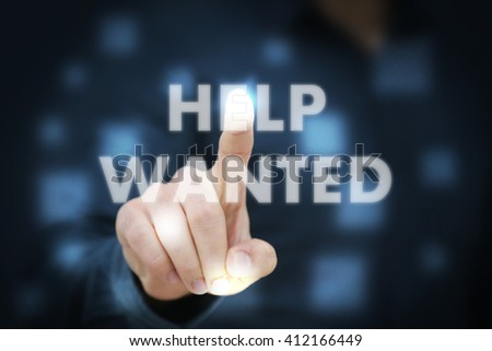 Businessman touching Help Wanted - stock photo