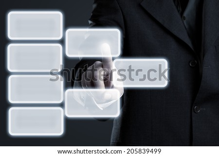 Businessman touching hierarchy infogram graphics on virtual touchscreen with copy space - stock photo