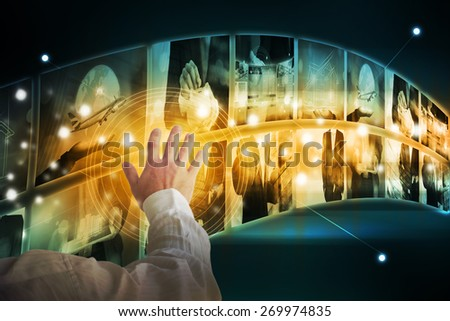 Businessman touching high tech interface - stock photo