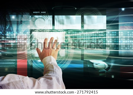 Businessman touching high tech interface - stock photo
