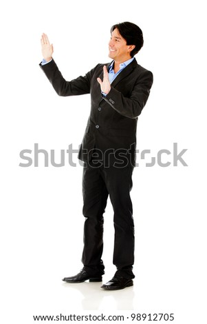 Businessman touching imaginary object with hands - isolated - stock photo