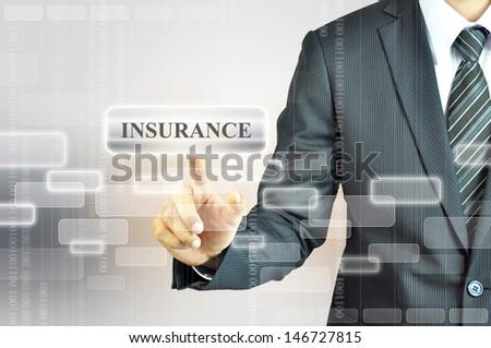 Businessman touching INSURANCE sign on virtual screen - stock photo