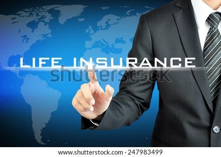 Businessman touching LIFE INSURANCE sign on virtual screen - stock photo