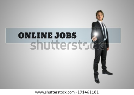 Businessman touching - Online jobs - navigation bar on a virtual screen with his finger from behind in a conceptual image. - stock photo
