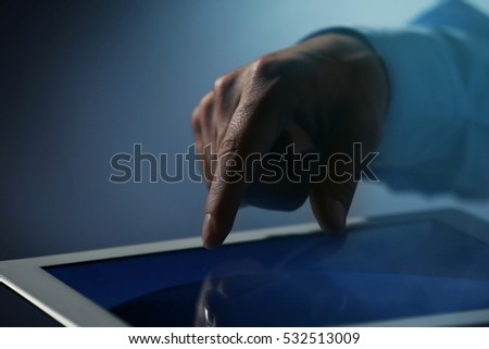 Businessman touching screen of modern tablet, closeup