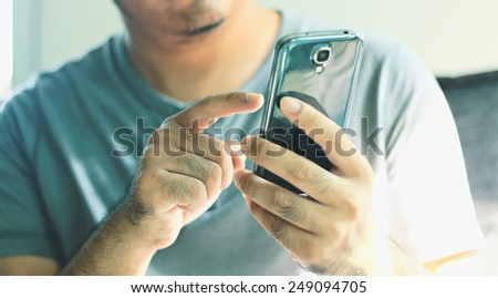 Businessman touching screen on digital tablet. - stock photo