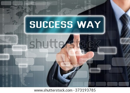 Businessman touching SUCCESS WAY sign on virtual screen