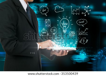Businessman touching tablet analysis strategy plan the future. - stock photo