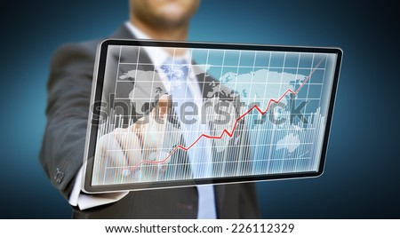 Businessman touching tablet multimedia with his fingers