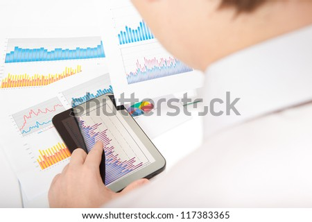 Businessman touching touchscreen digital tablet and analyzing financial chart - stock photo