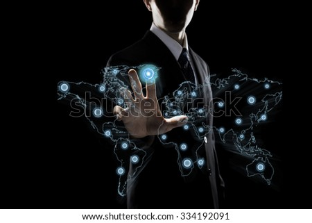 Businessman Touching Transparent Screen With Globe Icon - stock photo
