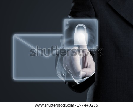 Businessman touching virtual futuristic display with icon for secure email communication - stock photo