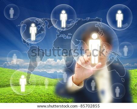 Businessman touching virtual screen on nature background. - stock photo