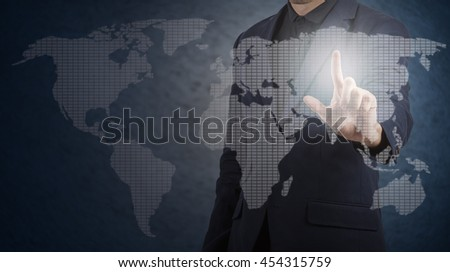 businessman touching world map on virtual screen,business concept - stock photo
