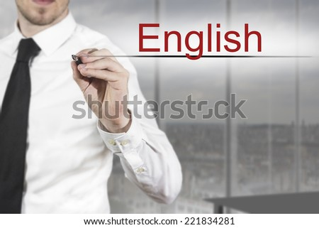 businessman translator in office writing english - stock photo