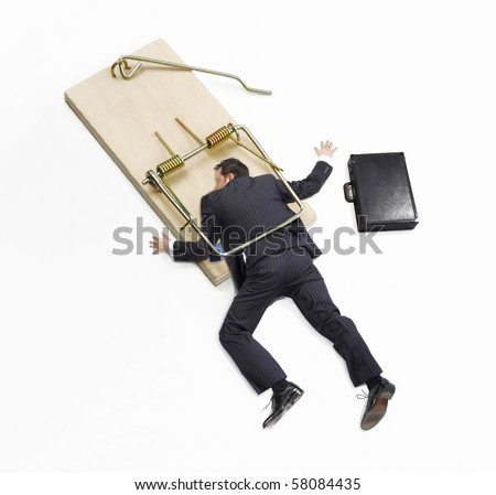 Businessman trap,businessman failure,businessman on mousetrap on white background. - stock photo