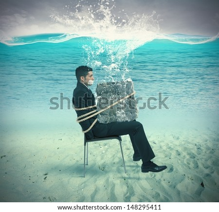 Businessman trapped in a chair with rope - stock photo