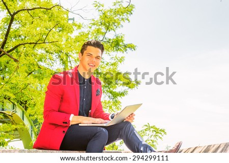 Businessman traveling, working in New York. Dressing in red blazer, blue collarless shirt, pants, leather shoes, a young guy sitting on street, smiling, reading, working on laptop computer. Copy Space