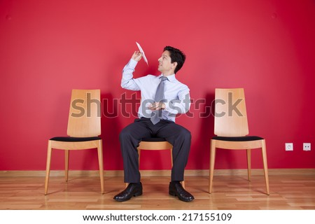 Businessman trowing paper planes - stock photo