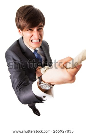 businessman trying to climb a rope upwards - stock photo
