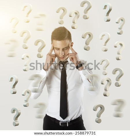 Businessman trying to find a solution. Businessman standing in a question marks and a solution has come - stock photo