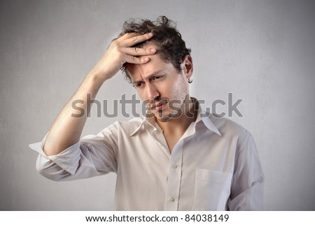 Businessman trying to remember something - stock photo