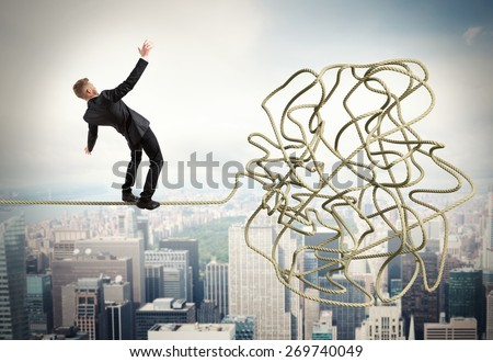 Businessman trying to solve a confusing problem - stock photo