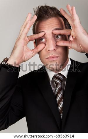Businessman trying to stay awake - stock photo