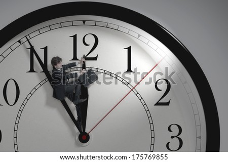 Businessman trying to stop time. Time Management. Cure for old age. Deadline.Time pressure