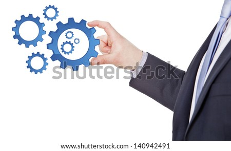 businessman turn gear of mechanism isolated on a white background - stock photo