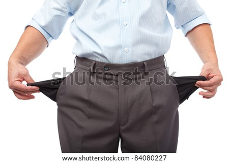 Businessman turning his empty pockets inside out, isolated on white background - stock photo