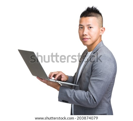 Businessman type laptop computer - stock photo