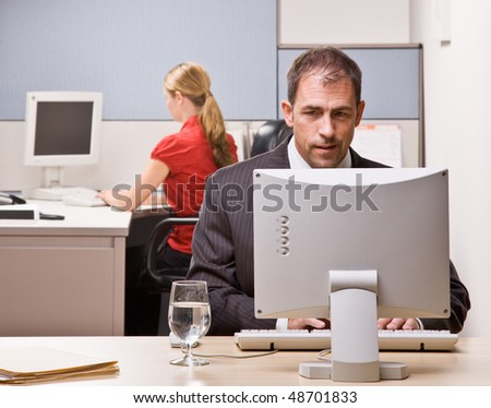 Businessman typing on computer at desk - stock photo