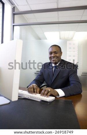Businessman typing on computer keyboard